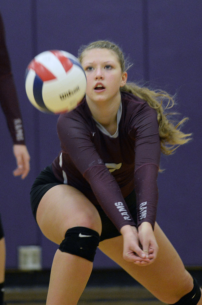 Gorham's Diana Kolb receives a serve from Cheverus in Thursday's Class A prelim match in Portland.