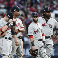 Boston Red Sox infielders, from left, Brock Holt, Xander Bogaerts, Dustin Pedroia and Hanley Ramirez wait during a pitching change in the sixth inning.