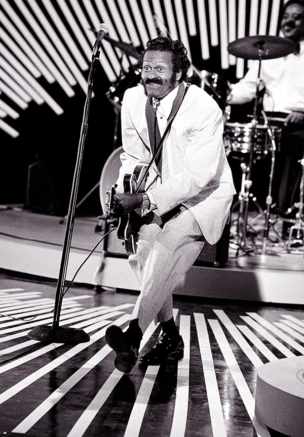 "Chuck Berry performs his ""duck walk"" in 1980. The location is not known. Associated Press"