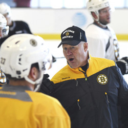 Bruins coach Claude Julien might have to rely on a few rookies in key positions to help earn wins this season .    Faith Ninivaggi/The Boston Herald via AP