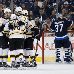 The Bruins' Brandon Carlo (25), David Pastrnak (88), Zdeno Chara (33) and David Backes (42) celebrate Pastrnak's goal in second period Monday night in Winnipeg, Manitoba. John Woods/The Canadian Press via AP