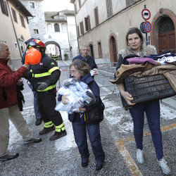 Residents carry some of their belongings in the small town of Visso in central Italy Thursday, after a 5.9-magnitude earthquake destroyed part of the town. A pair of strong aftershocks shook central Italy late Wednesday, crumbling churches and buildings, knocking out power and sending panicked residents into the rain-drenched streets just two months after a powerful earthquake killed nearly 300 people. Associated Press/Alessandra Tarantino