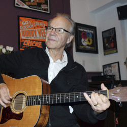 Bobby Vee plays the guitar at his family's Rockhouse Productions in St. Joseph, Minn., in December 2013. Associated Press/Jeff Baenen