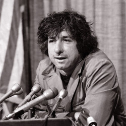 Political activist Tom Hayden, answering questions at a news conference in Los Angeles in 1973, says public support was partially responsible for the judge's decision not to send him and others of the Chicago 7 to jail for contempt. Associated Press/George Brich