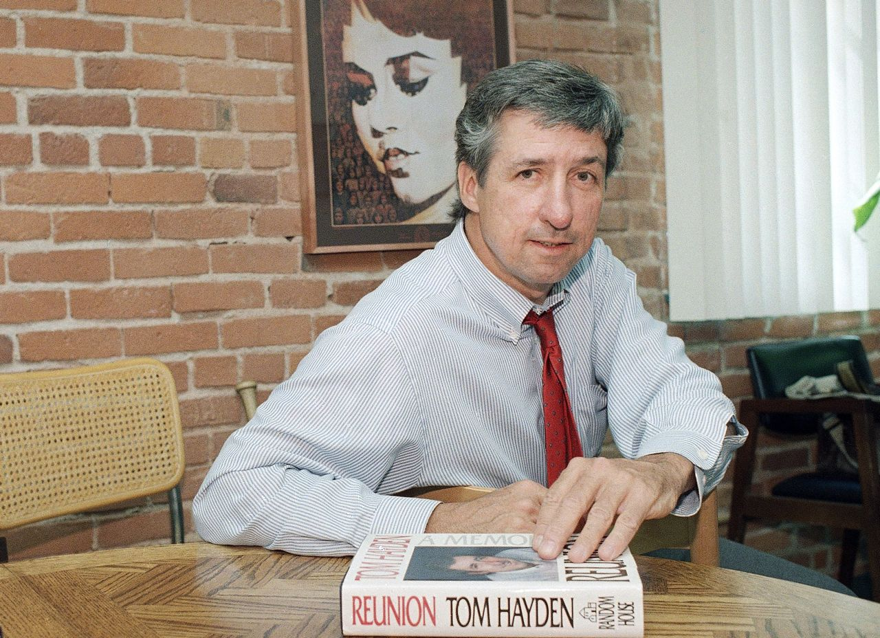 "Tom Hayden talks about his new book, ""Reunion,"" during a 1988 interview at his office in Santa Monica, Calif. Associated Press/Lennox McLendon"