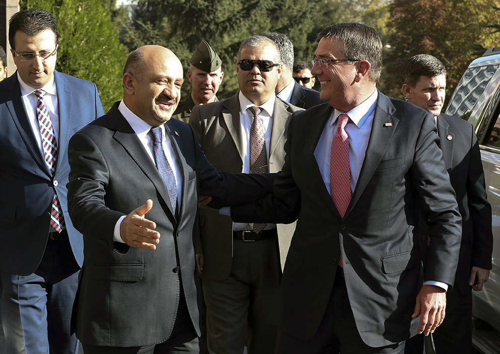 U.S Secretary of Defense Ash Carter, right, and his Turkish counterpart Fikri Isik arrive for a meeting at Defense Ministry in Ankara, Turkey, Friday, amid escalating tensions between Turkey and Iraq over Turkish military operations in northern Iraq. Ozgur Yurdakadim/Turkish Defense Ministry via Associated Press