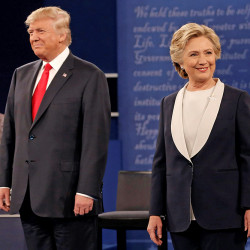 Republican U.S. presidential nominee Donald Trump and Democratic U.S. presidential nominee Hillary Clinton appear together during their presidential town hall debate at Washington University in St. Louis, Missouri, U.S., October 9, 2016.   REUTERS/Mike Segar - RTSRIU0
