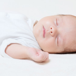 The new recommendations say babies should sleep on a separate surface, in a crib or bassinet, and never on something soft. Shutterstock/Ventura