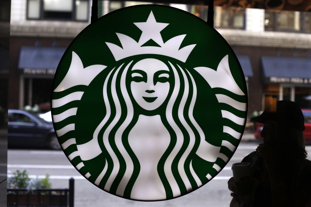 Starbucks posts higher quarterly revenue, issues cautious forecast